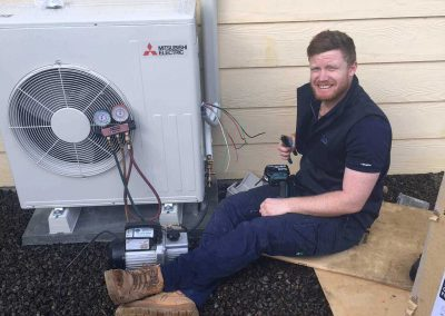 On site, installing a client's air conditioning unit in an Adelaide suburb